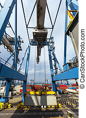 Port Crane Transferring Container - A massive freight crane...