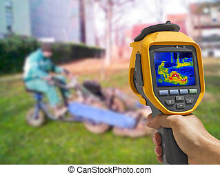 Recording with Thermal camera workers cutting grass in city...