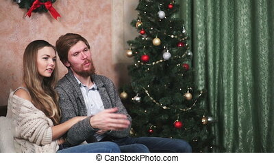 couple man with the woman at the Christmas tree