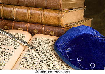 Old jewish books - Silver Torah pointer lying on antique...