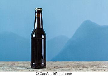 Beer bottle over blue