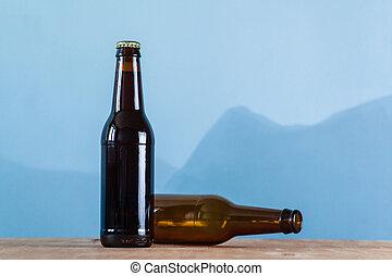 Beer bottles over blue