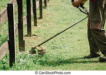 Golf course maintenance equipment, grass trimmer