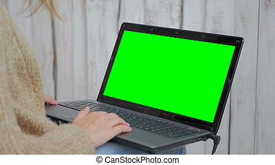 Woman using laptop with green screen. Business,...