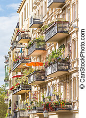 Traditional European Balcony with colorful flowers and...