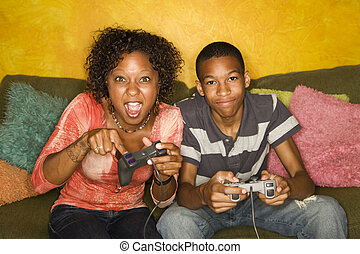 African-American family playing video game - Good-looking...