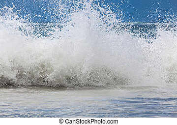 Large ocean waves with white foam. The raging ocean storm. -...