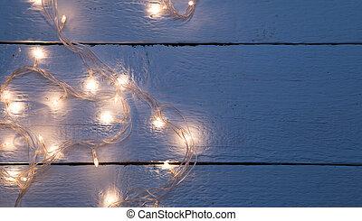 Festoon on empty wooden floor - New year festoon on empty...