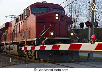Freight Train at a Crossing - A freight train passes through...