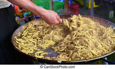 Golden potato dumplings with sauerkraut in a big pan -...