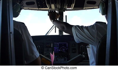 View to the cockpit of an airplane - Two pilots on an...