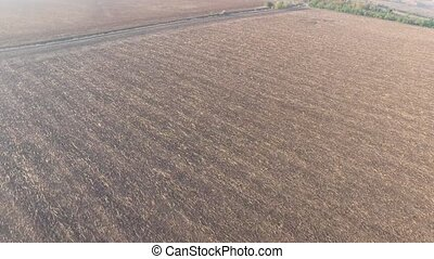 Flying high above the arable land with country road - Flying...