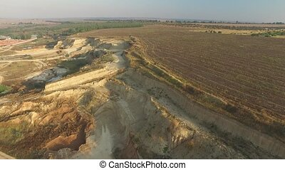 Sandy quarry near the arable land outside the city - Sandy...