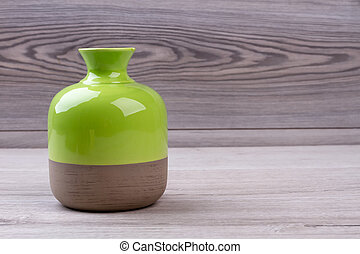 Ceramic vase on wooden background. Close-up shiny vase....