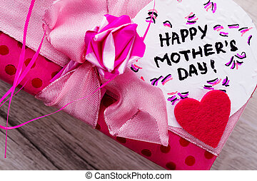 Happy Mother`s Day card inscription. Pink bow on gift box....