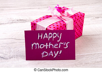 Happy Mother`s Day gift. Greeting card aside pink box....
