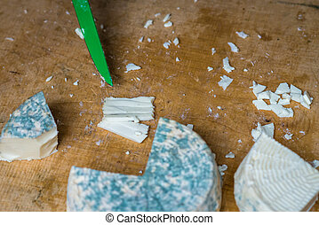 pieces of cheese with blue mold - a pieces of cheese with...