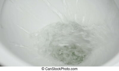 Cleaning of the toilet bowl using the water stream. The...