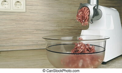 Making of ground beef using electric meat grinder - The...