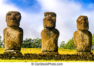 Three Moai Statues - Three Moai statues on Easter Island,...