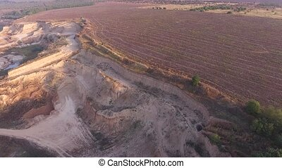 Flying over the sand pit and a plowed field - Sandy quarry...