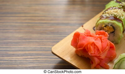 Fresh sushi on the table in motion in Japanese restaurant