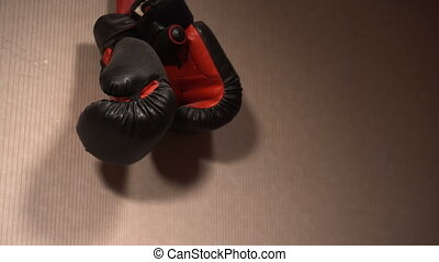 Boxing gloves on the wall waiting for next training