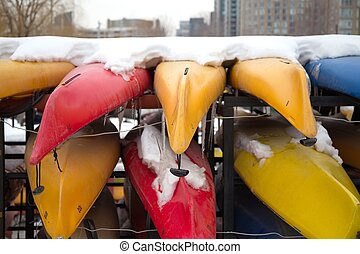 Kayaks under snow