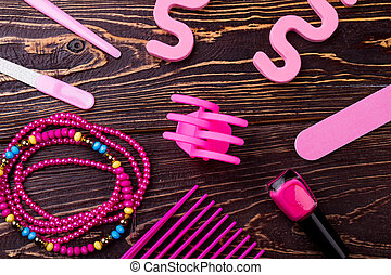 Pink make-up accessories. Nail file, polish and separator....