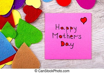 Happy Mother`s Day note. Greeting paper and colorful hearts....