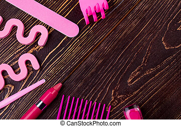 Manicure kit on wooden background. Comb, lipstick, nail...