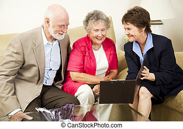 In Home Sales - Saleswoman meets with senior couple in their...