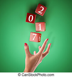 Bet on the happy new year - Dice rolled by a hand. Bet on...