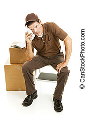 Tired Mover or Delivery Man - Mover or delivery man sits...