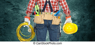 Electrician with helmet and cable. - Builder handyman with...