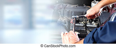 Hands of car mechanic in auto repair service. - Hands of car...