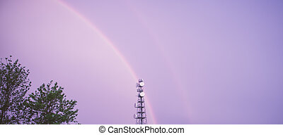 Radio tower in Queensland with a rainbow. - Radio tower in...