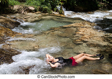 Tourist Relaxing Jamaica - Young woman tourist relaxes in a...