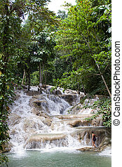 Woman On Dunn\'s Falls Jamaica - Young female tourist starts...