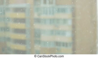 look at the snow from the windows of skyscrapers urban