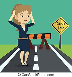 Businesswoman looking at road sign dead end. - Caucasian...