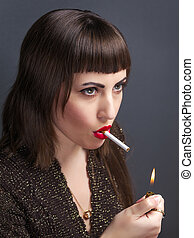 A woman lights a cigarette. A young girl with a cigarette in...