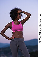 portrait of african american woman jogging in nature -...