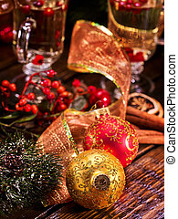 Christmas balls closeup. Glasses with a punch in the...