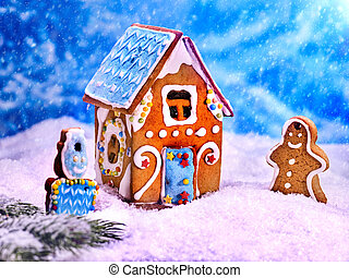 Beautiful gingerbread cookie house on a background of blue...