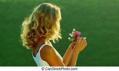 Girl on a green background - Girl with a bouquet of field...