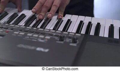 View of pianist playing modern electrical piano - Piano...