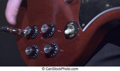 Guitarist playng electrical guitar in studio - Guitarist...