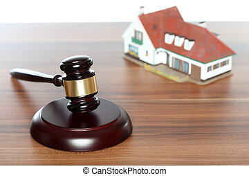 symbolic auctioneer with gavel and house model