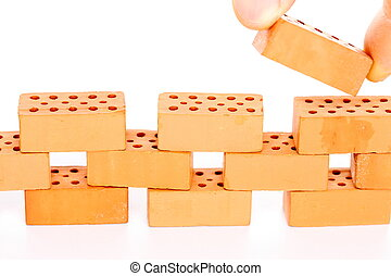 a wall with red bricks on white background